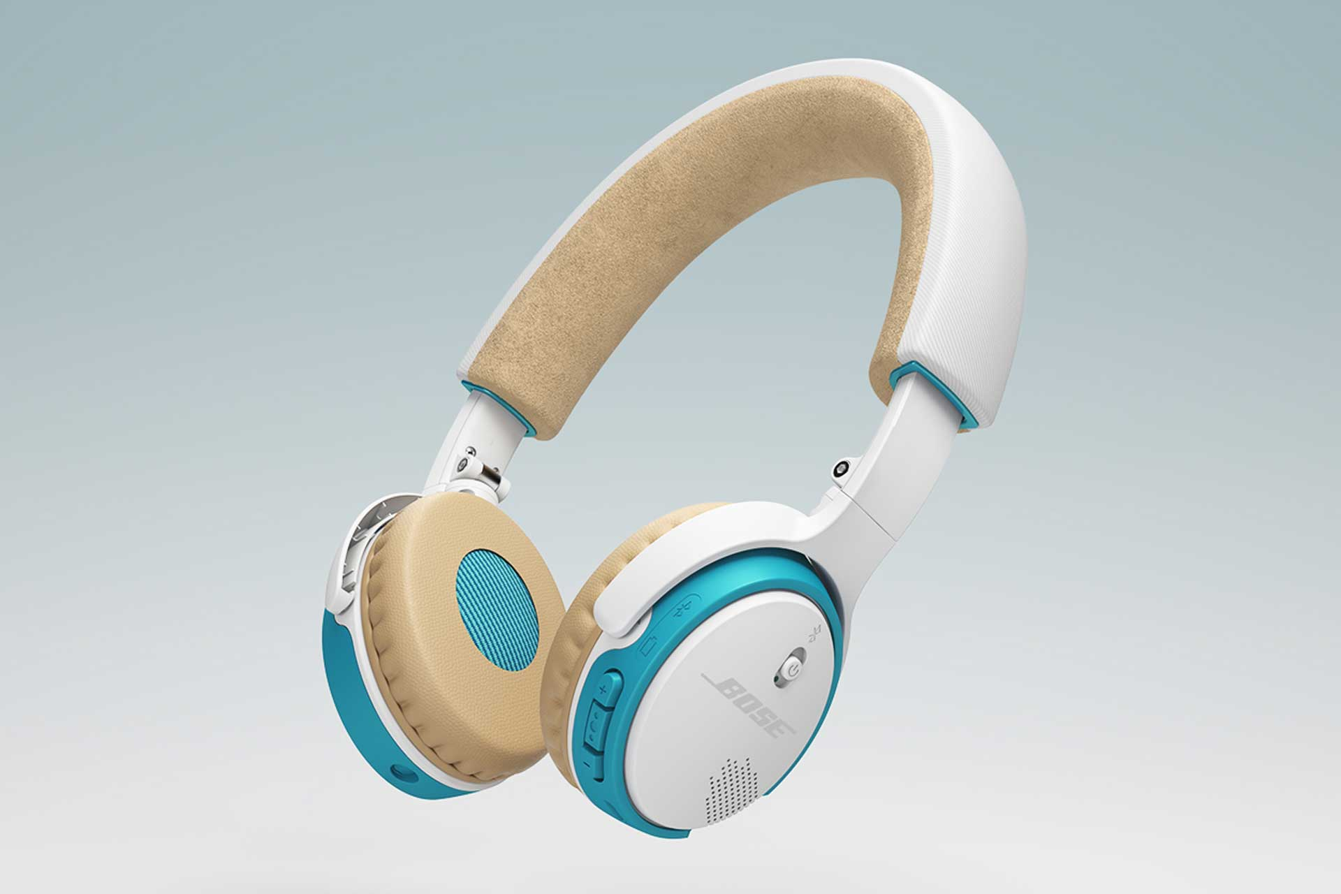 Side view image of blue, white, and tan BOSE wireless headphones