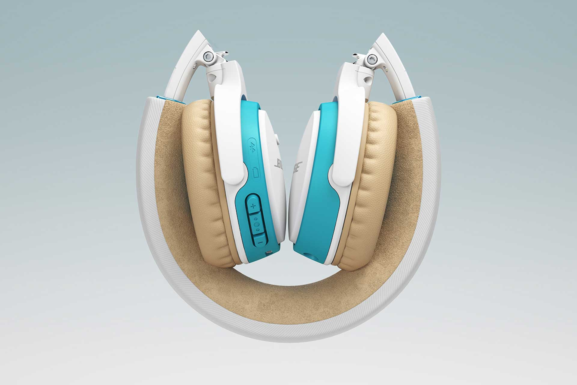 Close view of folded blue, white, and tan BOSE wireless headphones