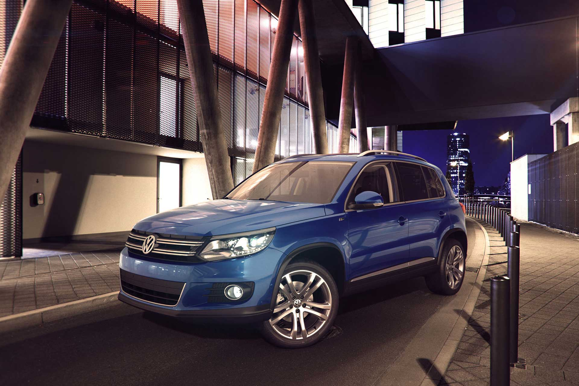 Blue Volkswagen Tiguan car parked in the city