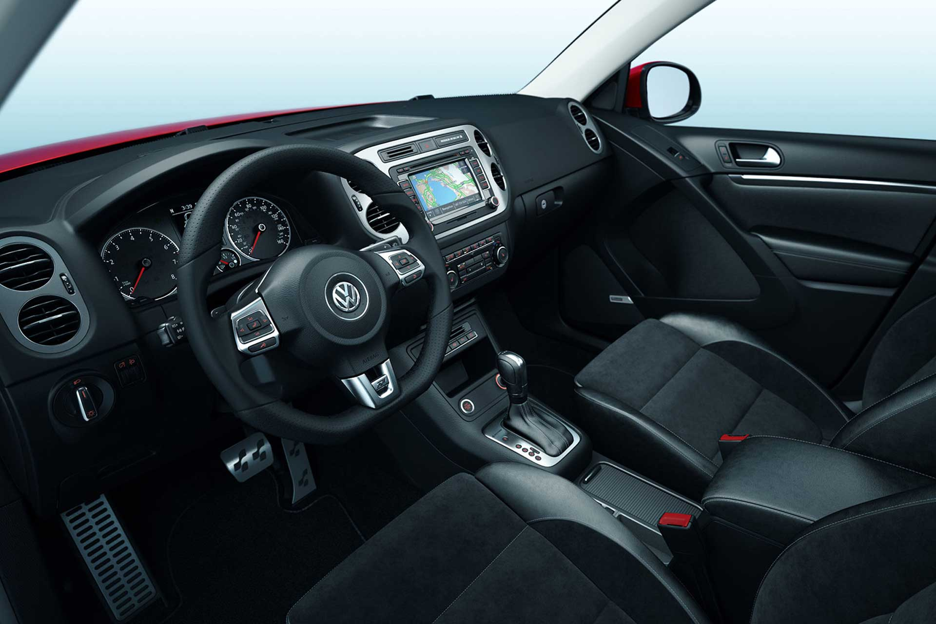 Interior view of VW Tiguan with black leather seats and a digital display