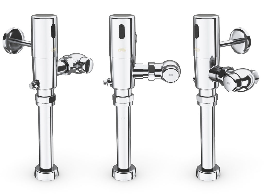 Three chrome-plated sensor flush valves for water closets manufactured by Zurn