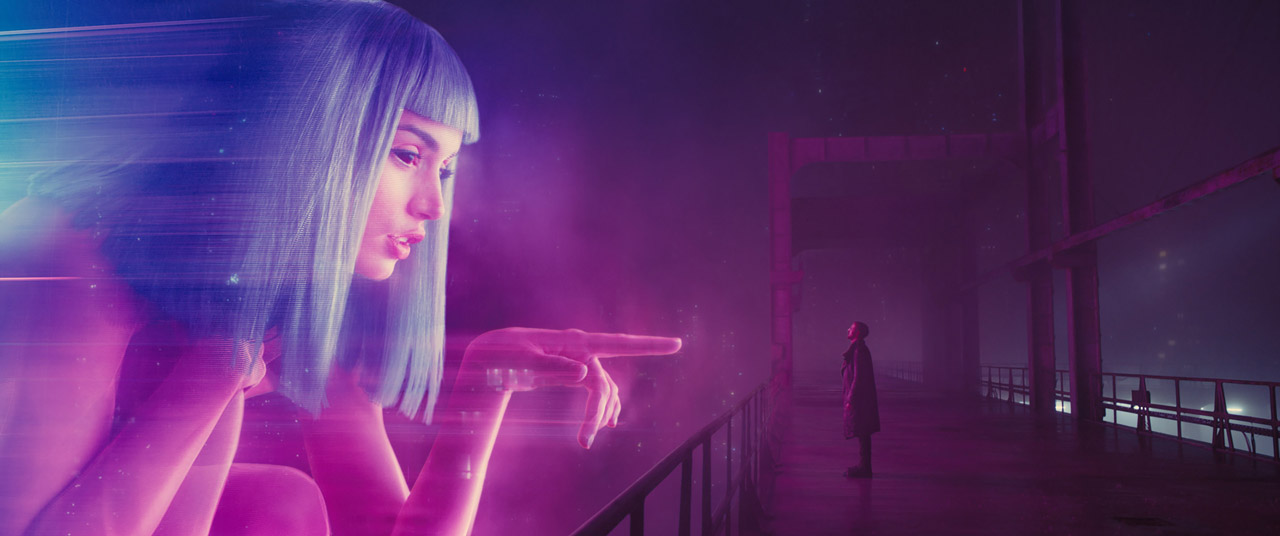 Still from Blade Runner featuring blue and pink holographic woman