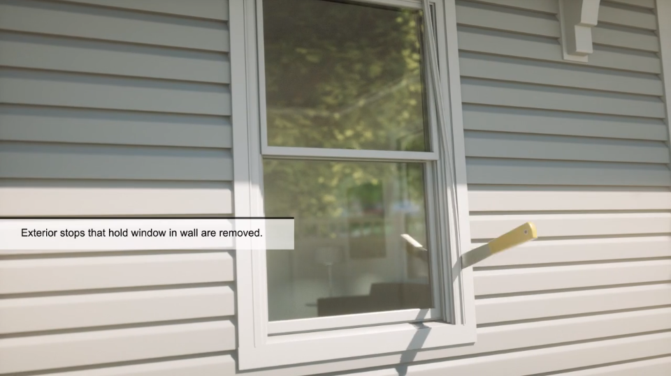 "Exterior window on the side of a home with the text ""Exterior stops that hold windows in wall are removed"" from window installation training material"