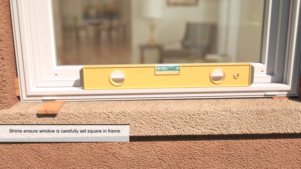 "Exterior window ledge with a level in the center and text reading ""Shims ensure window is carefully set square in frame."" from window installation training material"