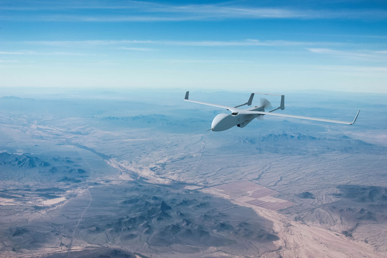 Gray Insitu drone flying over rocky terrain in a large-scale environment image