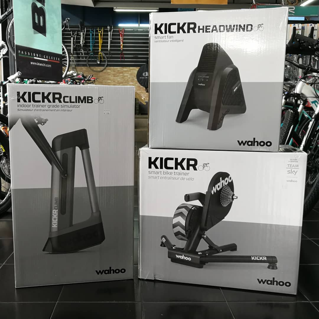 Three white and gray product boxes for KICKR Climb bike trainers