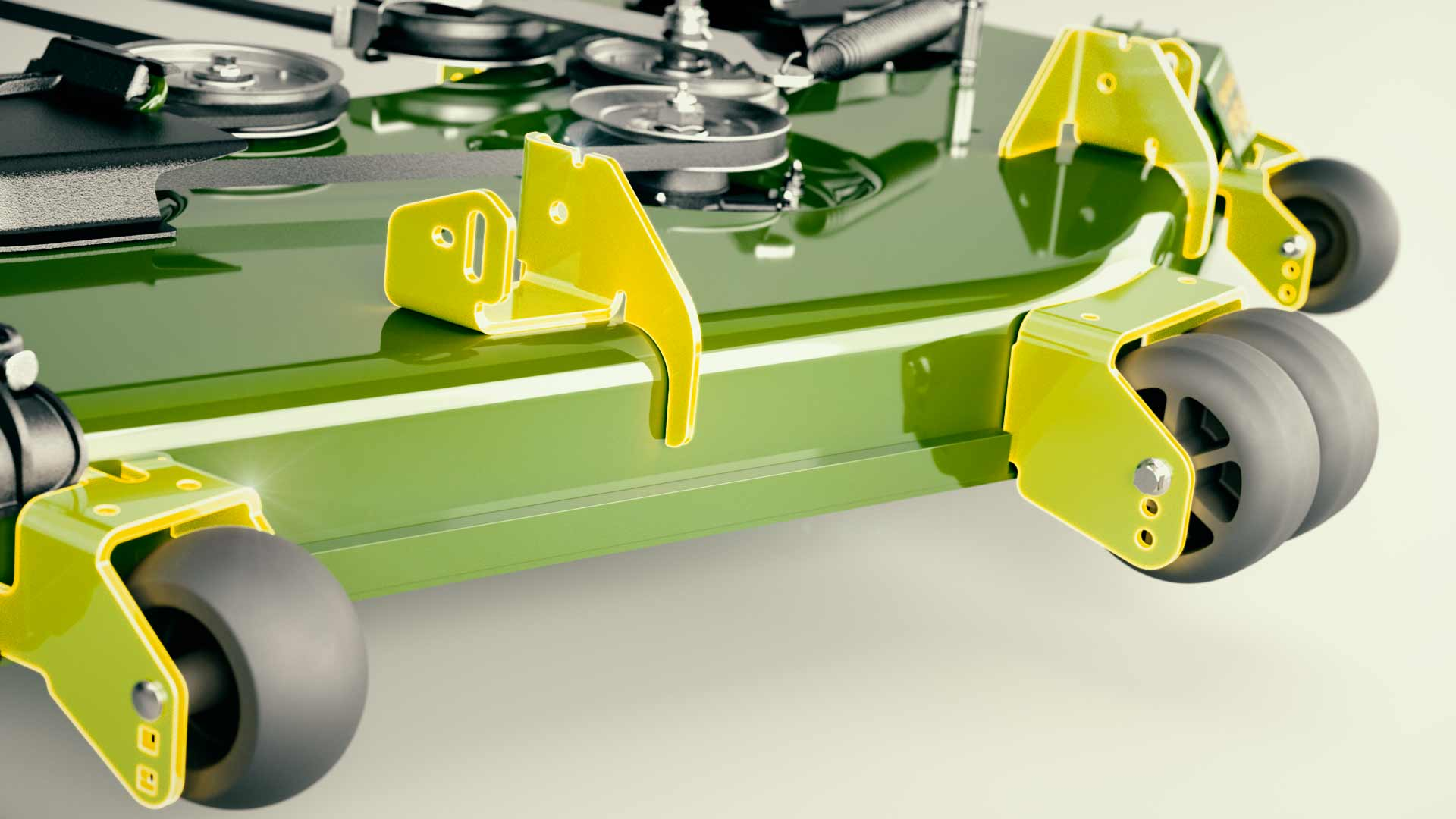 Close view of wheel brackets on green John Deere mower deck
