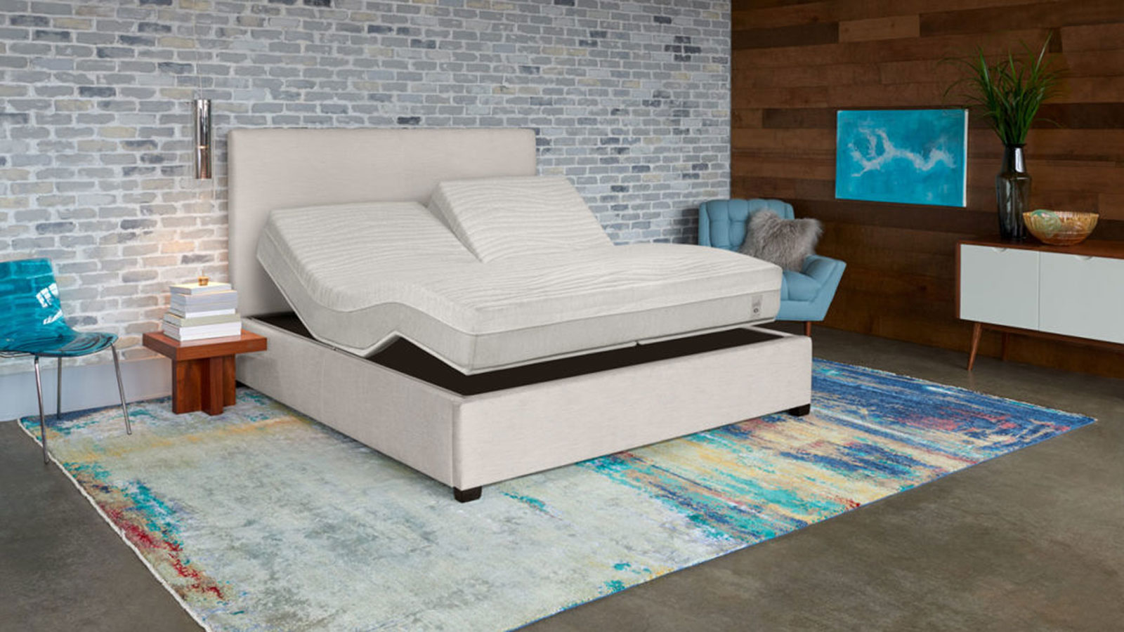 Adjustable mattress and frame in bedroom with exposed brick wall