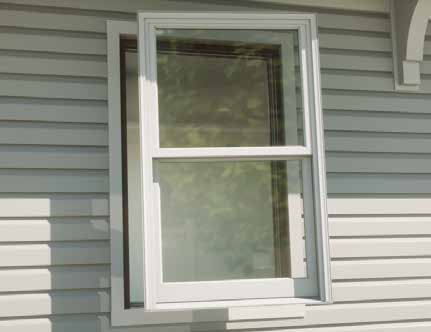 Pella double hung window pane being installed in a home