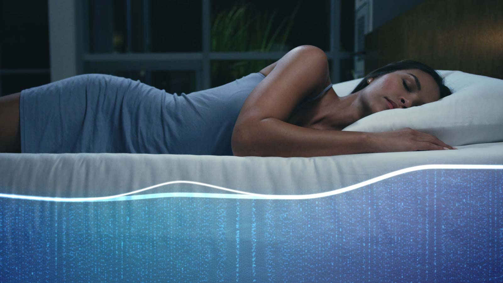 Woman lying on bed used for sleep number trade show visuals