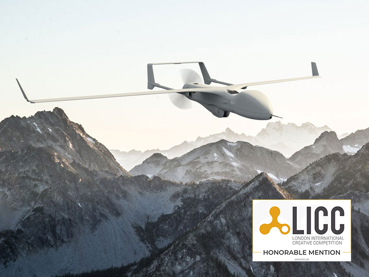 Gray drone flying over mountain range in a large-scale environment
