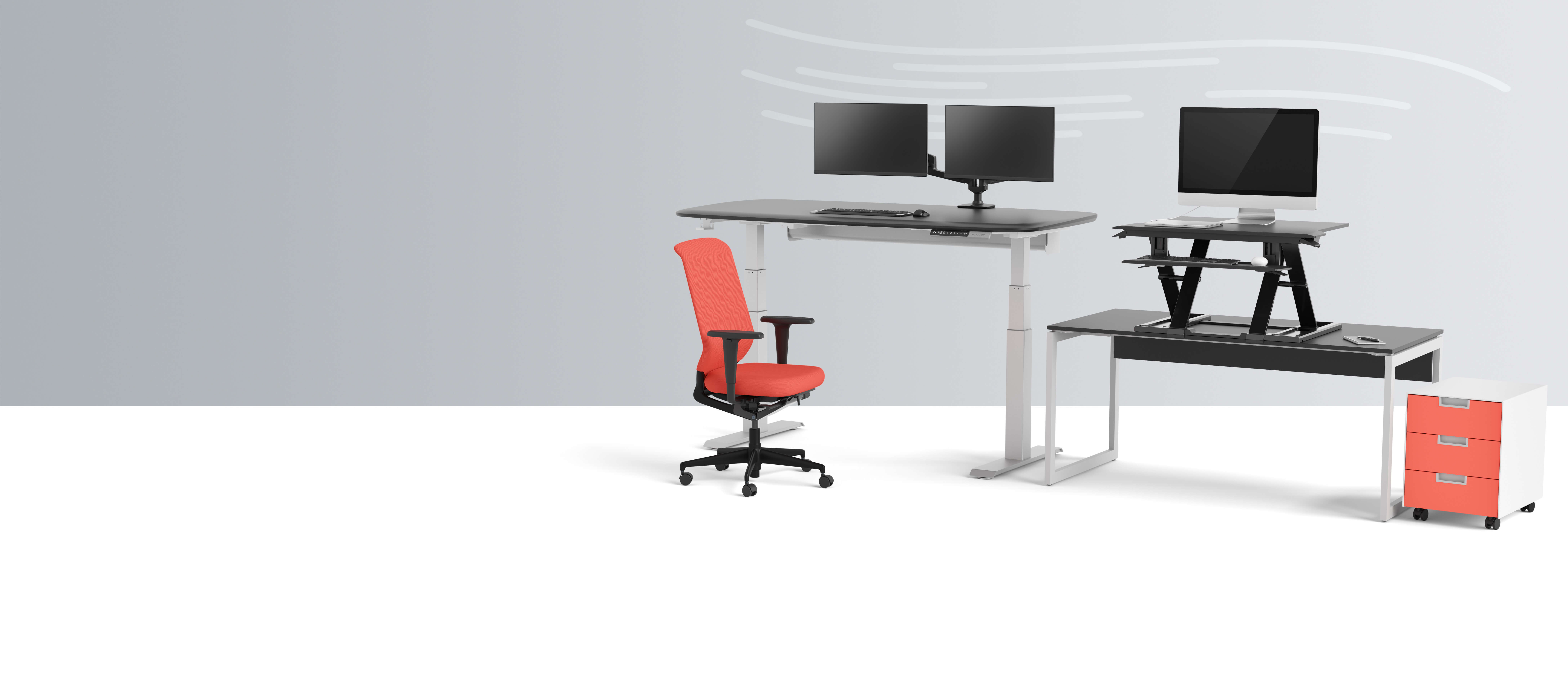 Two desks with orange chair