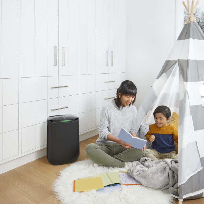 image of mom and son reading in kids bedroom